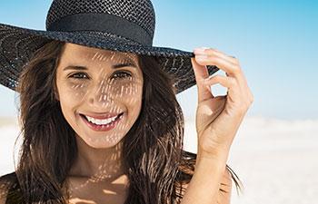 Young joyful woman on the beach.