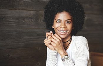 Attractice Afro-american woman wearing braces.