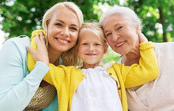 A schoolgirl with her mother and grandmother.