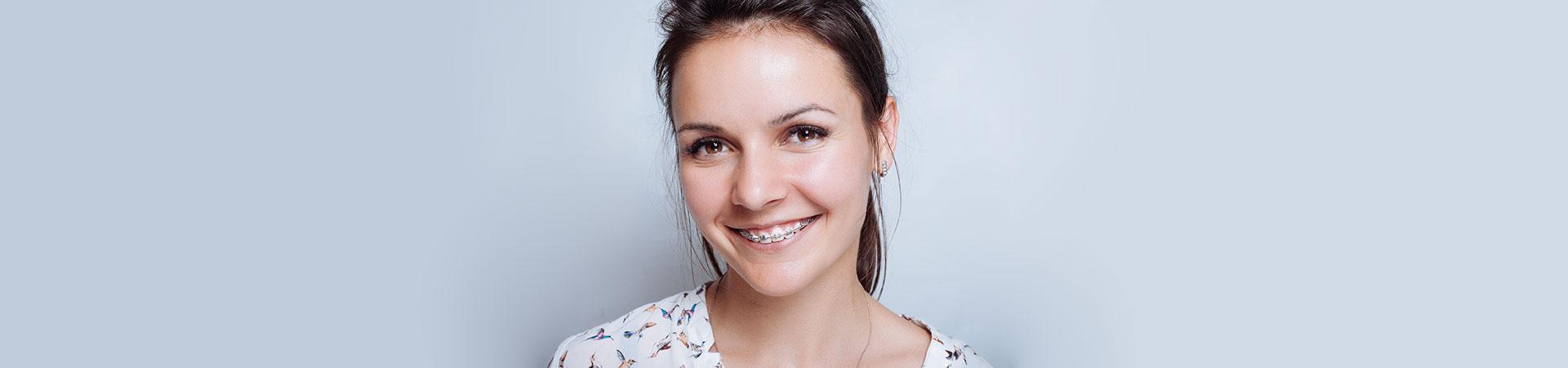 Adult woman wearing orthodontic braces.