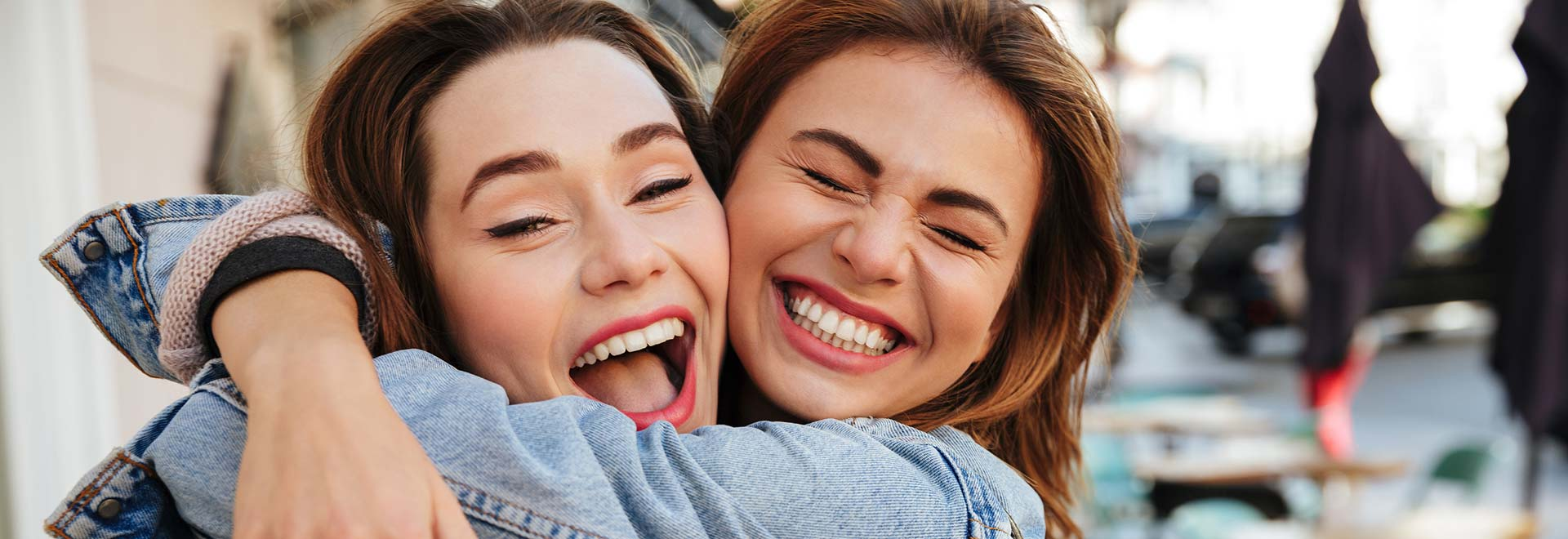 Close up photo of laughing women.