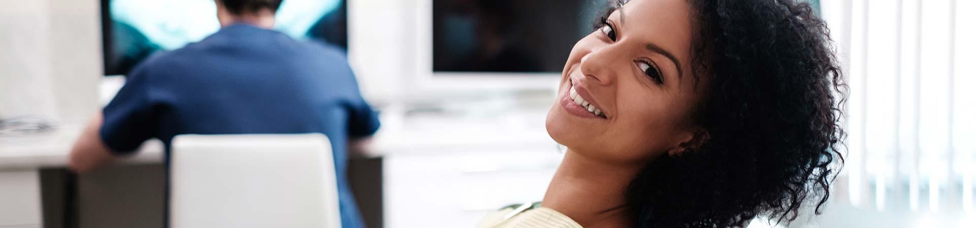 Woman at dental chair Marietta, GA.